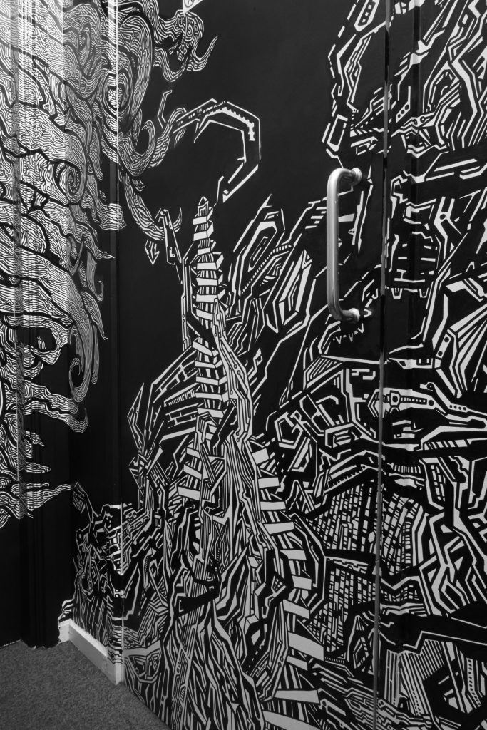 Block T illustrated, detailed cityscape and girl's hair line drawing with permanent markers installation graffiti wallart piece in Smithfield by Dublin based illustrator John Rooney..